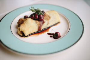 savory crepes stuffed with sauteed chicken livers with cherry balsamic reduction