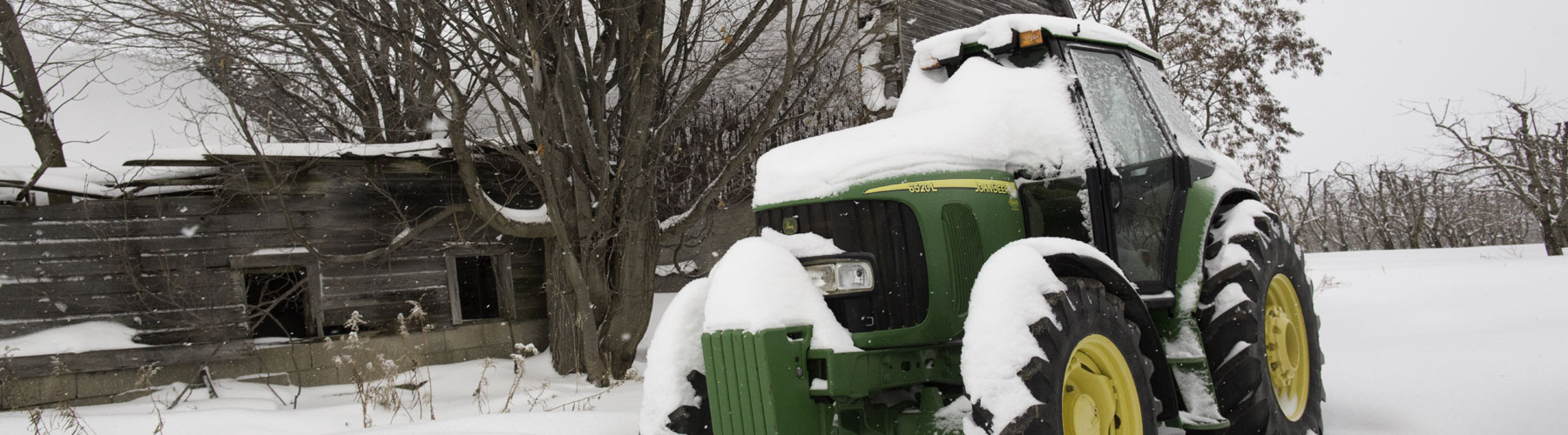 John Deer tractor covered in snow
